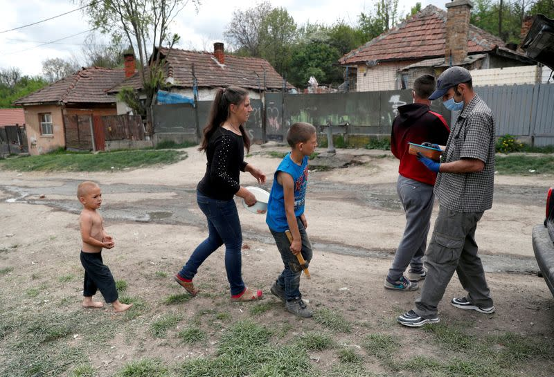FILE PHOTO: A Roma family arrives to receive a food donation in a deprived neighbourhood during the coronavirus outbreak in Miskolc, Hungary