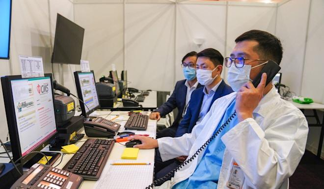 (From left to right) Larry Lee, of Tin Shui Wai Hospital; Ivan Hung, of University of Hong Kong; and Dr Polk Wan, of North Lantau Hospital, demonstrate the system in the tele-care centre at the AsiaWorld-Expo Community Treatment Facility. Photo: Sam Tsang
