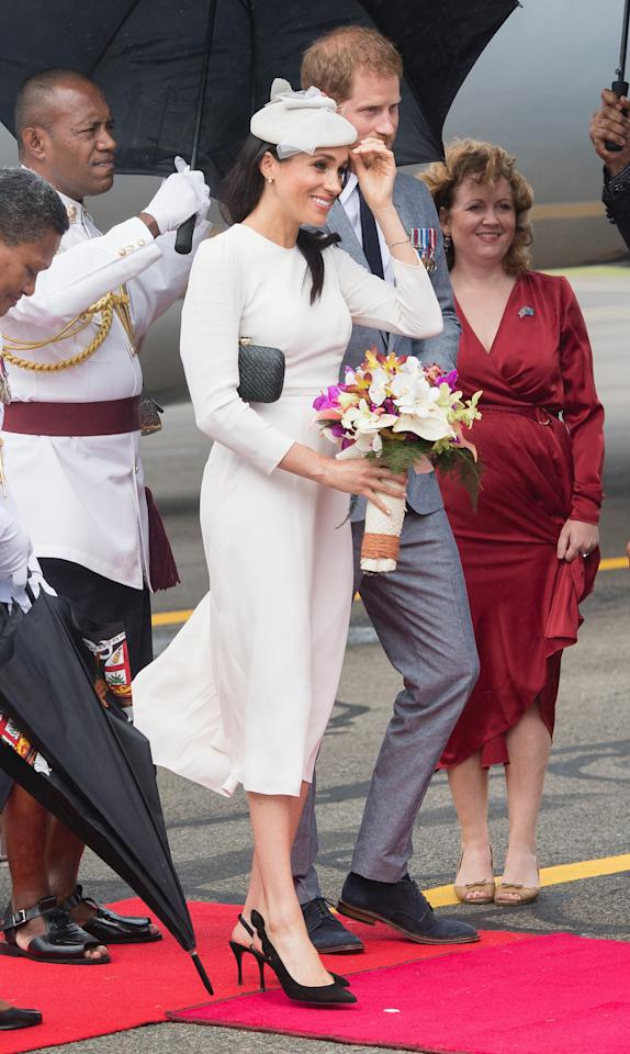 <p></p><p>Meghan Markle was the elegant Duchess when she touched down in Fiji alongside Prince Harry on Tuesday afternoon. The 37-year-old arrived at Nausori airport in a customised version of Australian label Zimmermann's 'long sleeve white dress', teamed with a delicate headpiece by Stephen Jones millinery.<br />Photo: Getty </p><p></p>