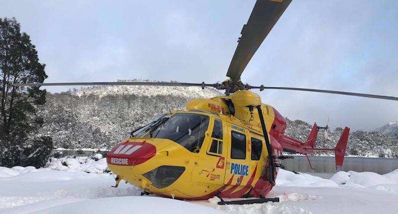 Photo of the Westpac Rescue helicopter sinking into the snow during a Tasmanian search mission.