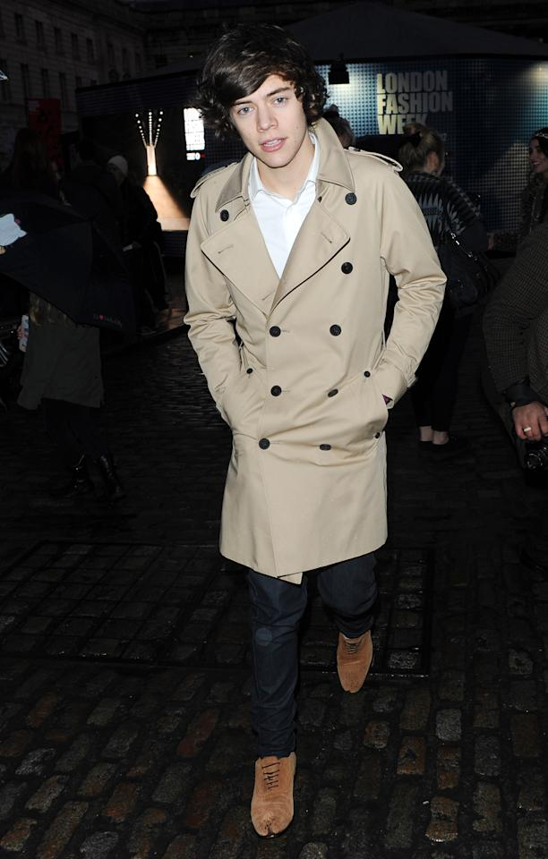 2012: Looking very British in a traditional trench coat