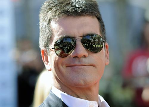 """FILE - Simon Cowell arrives at the """"American Idol"""" finale in this file photo dated Wednesday, May 26, 2010, in Los Angeles, USA. The impresarios Cowell's Syco Entertainment company on Thursday Feb. 28, 2013, has launched a year-long YouTube channel global online talent contest called You Generation, looking for talent in all kinds of arenas including musicians, photographers, makeup artists, magicians and chefs, with auditions in a different category of talent every two weeks and a grand final after one year. (AP Photo/Chris Pizzello, FILE)"""