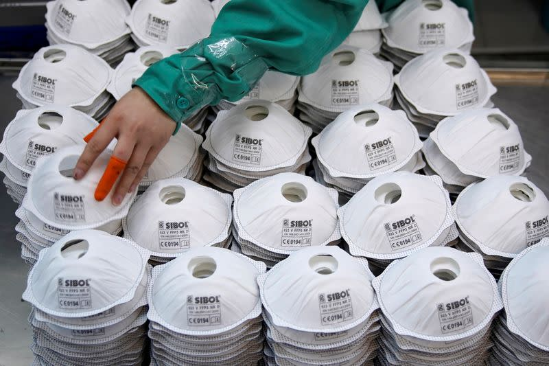 FILE PHOTO: FILE PHOTO: Masks are seen on a production line manufacturing masks at a factory in Shanghai