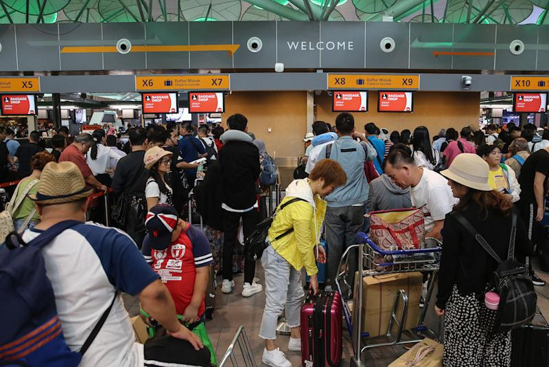Passengers are seen at KLIA2 in Sepang August 22, 2019, during a systems outage. — Picture by Yusof Mat Isa