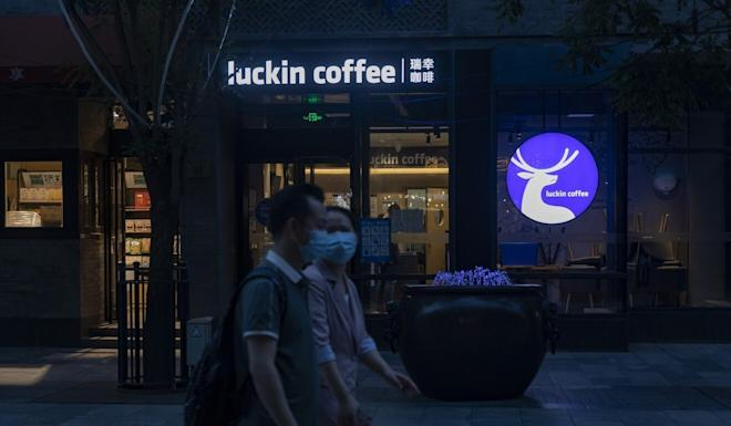 Pedestrians walk past a Luckin Coffee outlet in the Qianmen area of Beijing on Wednesday. Photo: Bloomberg