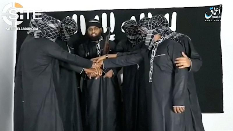 A group of men purported to be the the Sri Lanka bomb attackers is seen at an unknown location in this still image taken from video uploaded by the Islamic State's AMAQ news agency. Source: Reuters