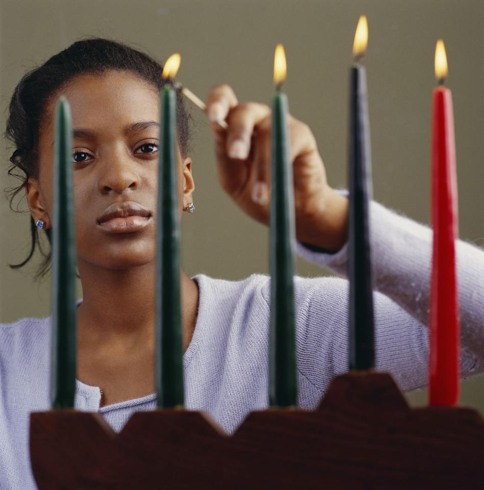 "<p>Dr. Karenga created seven guiding principles to be discussed during the week of Kwanzaa, representing seven values that help unite Black communities. Beginning on December 26, <a href=""https://www.history.com/topics/holidays/kwanzaa-history"" target=""_blank"">a new candle is lit each day on the <em>kinara</em></a>, or candleholder, beginning with the black candle in the center. The candles (three red, three green, and one black) are collectively known as <em>Mishumaa Saba</em>, or the Seven Candles. </p>"