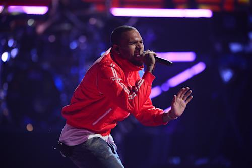 This Sept. 20, 2013 photo shows Chris Brown performing at the iHeartRadio Music Festival in Las Vegas, Nev. (Photo by Al Powers/Powers Imagery/Invision/AP)
