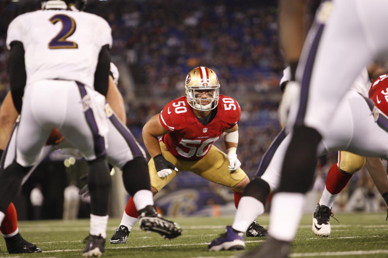 BALTIMORE, CA - AUGUST 7: Chris Borland #50 of the San Francisco 49ers defends during the game against the Baltimore Ravens at M&T Bank Stadium on August 7, 2014 in Baltimore, Maryland. The Ravens defeated the 49ers 23-3. (Photo by Michael Zagaris/San Francisco 49ers/Getty Images)