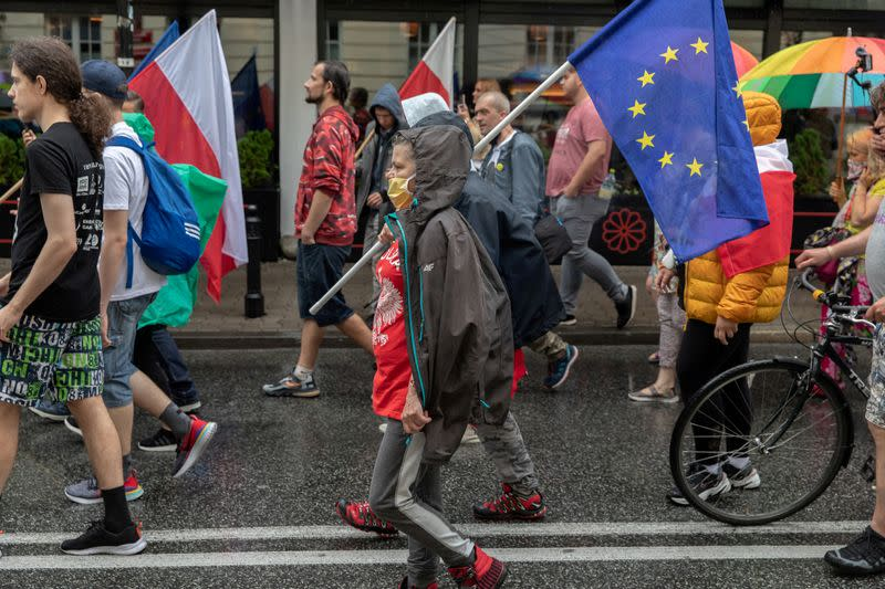 People participate in an anti-government demonstration in Warsaw