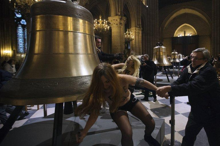 Activists from the Femen women's rights movement protest in Notre Dame cathedral in Paris on February 12, 2013