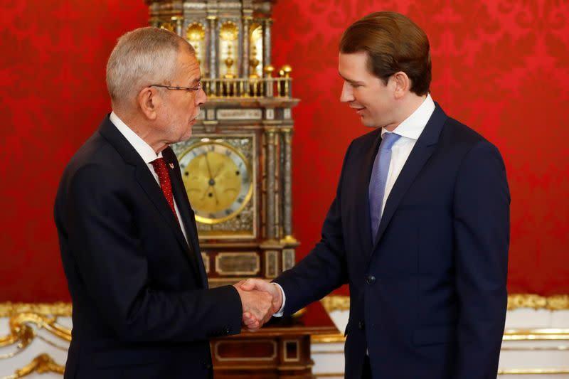 Austria's President Alexander Van der Bellen welcomes head of People's Party Sebastian Kurz the presidential office in Vienna