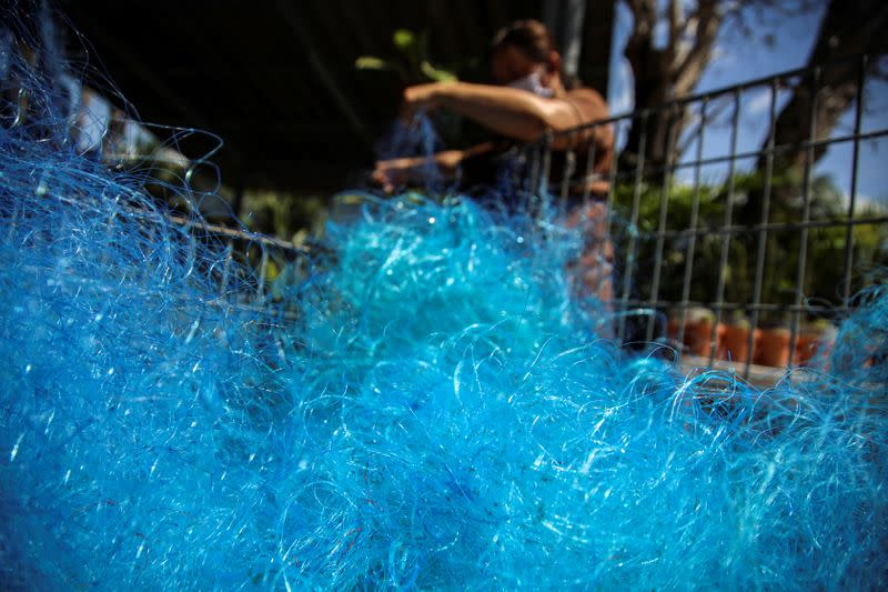 Net gains - Thai project turns fishing nets into virus protection gear