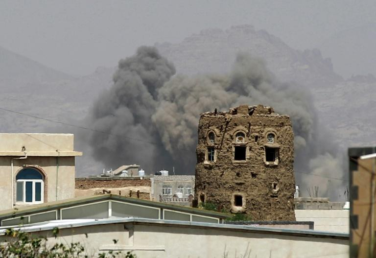 Smoke billows from buildings after reported air strikes in 2025 by the Saudi-led coalition on arms warehouses at an airbase controlled by Huthi rebels