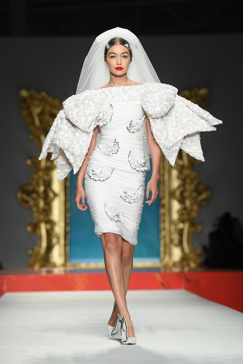 Gigi Hadid in a bride dress on the Moschino Milan Fashion Week catwalk