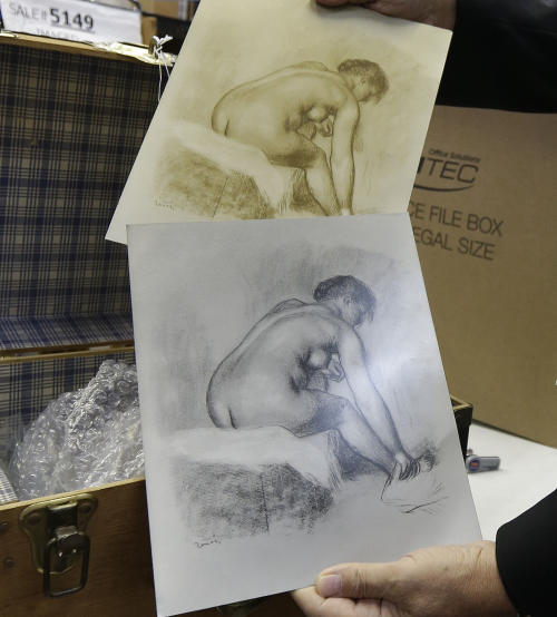 In this photo made Friday, Aug. 16, 2013, examples of a collection of copper plates by Pierre-Auguste Renoir are displayed in Dallas. The French artist's personal archive will be up for sale in New York City in September. (AP Photo/LM Otero)