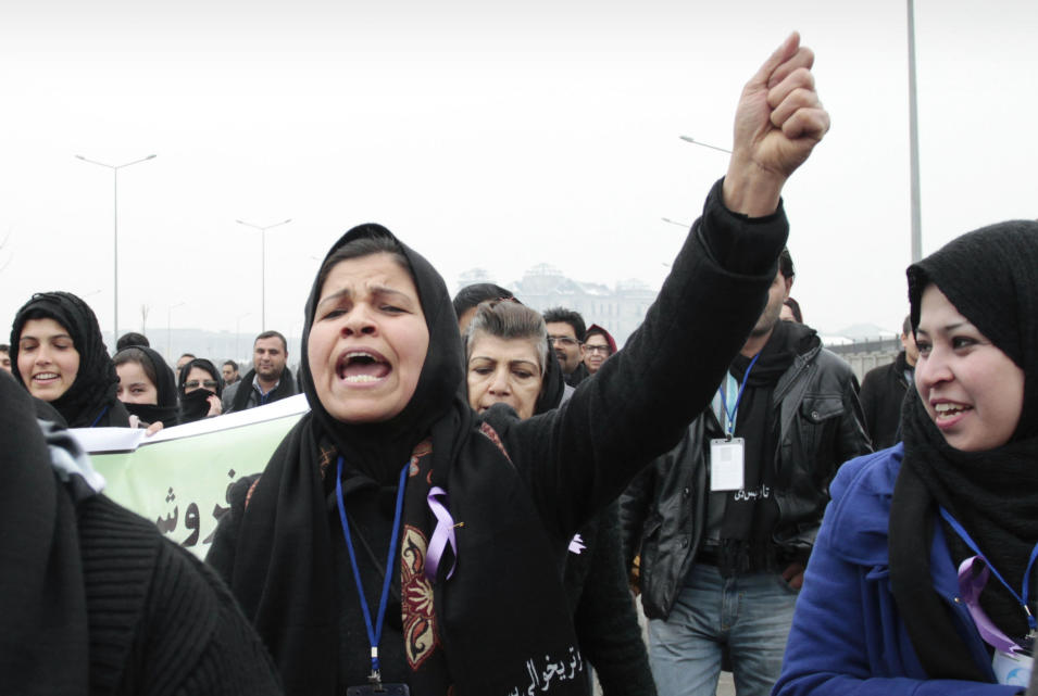An Afghan woman shouts during a march calling for the end of violence against women, in Kabul, Afghanistan, Thursday, Feb. 14, 2013. Dozens of Afghan activists have marked Valentine's Day by marching in Kabul to denounce violence against women. Concern has risen after rights organizations last year found that Afghan women are frequently victims of violence — despite a law against it and increased prosecution of abusers. (AP Photo/Musadeq Sadeq)