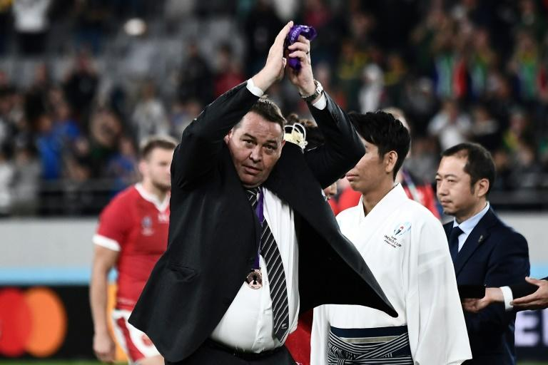 Steve Hansen leaves the pitch for the final time as All Blacks coach following the World Cup bronze final victory over Wales