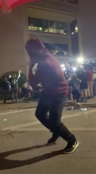 This still image taken from video provided by David Frost shows protesters running after police fire beanbag rounds in front of the Austin Police Department Headquarters on May 31, 2020 during a demonstration against police brutality in Austin, Texas. In some instances, police reacted with force so extreme that while their intent may not be to kill, the effects were devastating.  (David Frost via AP)