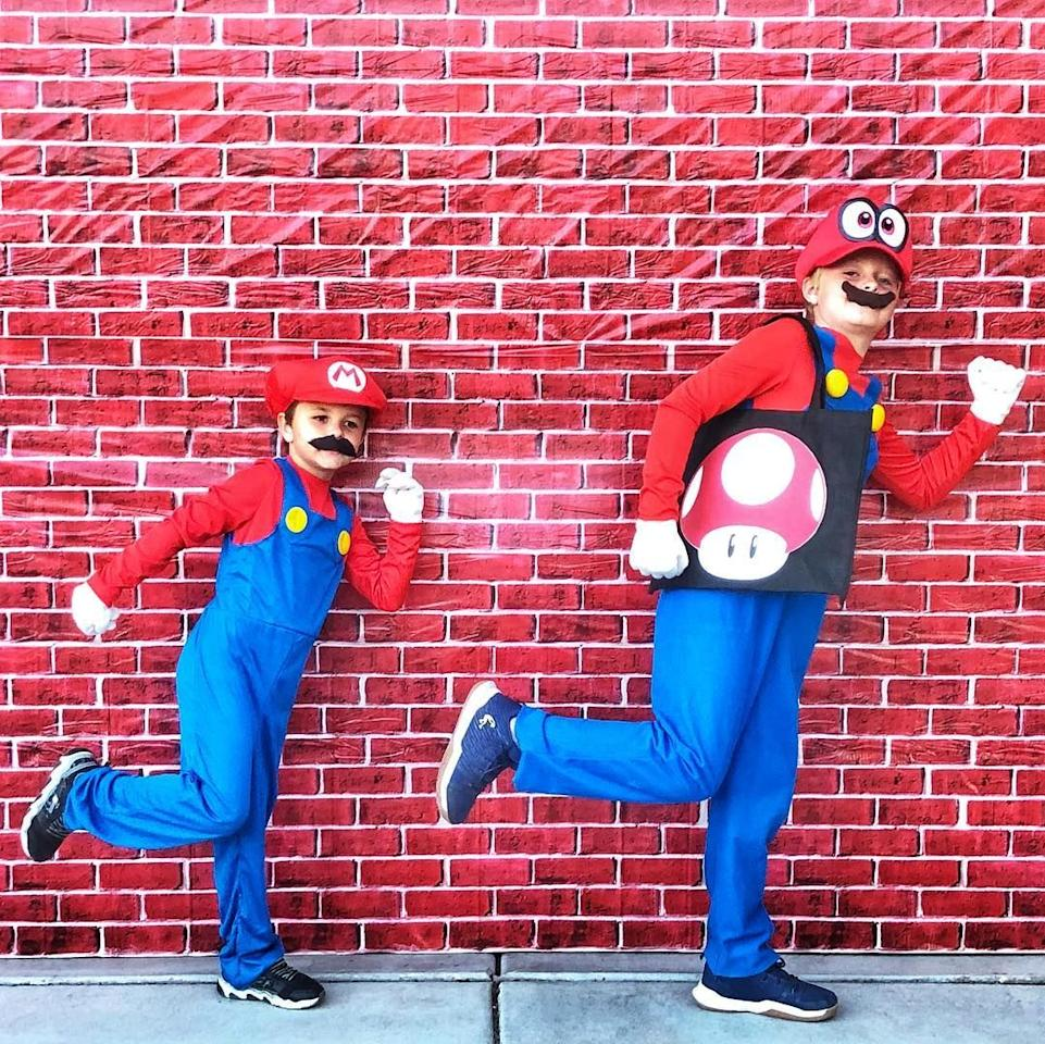 """<p>Your boys love playing video games, so why not dress them up as the main characters from the Mario franchise. These outfits are super easy to DIY (although you can also find dozens of <a href=""""https://www.amazon.com/Cloth-Kiss-Costume-Brothers-Halloween/dp/B07GV11B9T/?tag=syn-yahoo-20&ascsubtag=%5Bartid%7C10055.g.33417241%5Bsrc%7Cyahoo-us"""" target=""""_blank"""">premade versions</a> online). </p><p><a class=""""body-btn-link"""" href=""""https://www.amazon.com/Brothers-Costume-Halloween-Children-19-68-20-47Inch/dp/B07YJCSB7P/?tag=syn-yahoo-20&ascsubtag=%5Bartid%7C10055.g.33417241%5Bsrc%7Cyahoo-us"""" target=""""_blank"""">SHOP MARIO HATS</a></p><p><a href=""""https://www.instagram.com/p/BpqZGNYB8pb/?utm_source=ig_embed"""" target=""""_blank""""><em>See more on Instagram »</em></a></p><p><strong>RELATED: </strong><a href=""""https://www.goodhousekeeping.com/holidays/halloween-ideas/g33300912/sibling-halloween-costumes/"""" target=""""_blank"""">20 Clever Sibling Halloween Costumes That Will Make Your Family the Envy of the Block</a></p>"""