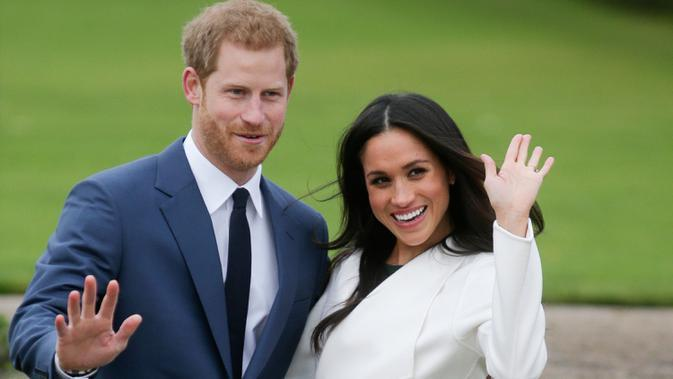 Pangeran Harry dan sang istri Meghan Markle membuat keputusan mengejutkan. Pasangan itu mengungkapkan keinginan untuk hidup mandiri dan mundur dari anggota senior kerajaan Inggris. (Files Photo by Daniel LEAL-OLIVAS / AFP)