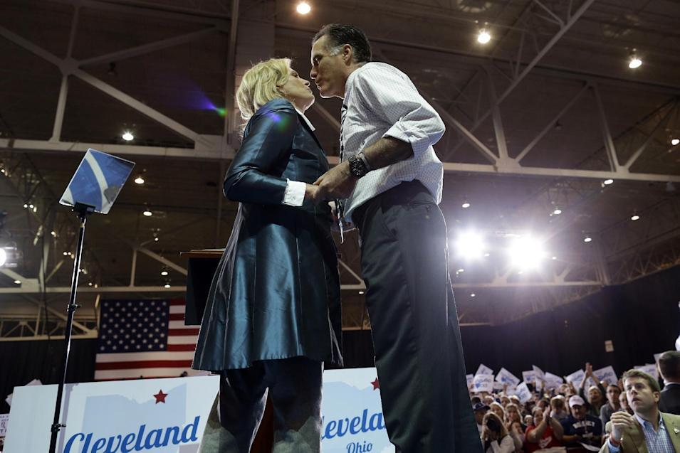 Republican presidential candidate and former Massachusetts Gov. Mitt Romney leans over to kiss his wife Ann after she introduced him as they campaign at the International Exposition Center in Cleveland, Sunday, Nov. 4, 2012. (AP Photo/Charles Dharapak)
