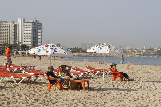 Sun, sand and surf: Israelis take a splash as beaches reopen