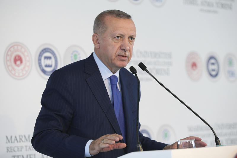 "Turkey's President Recep Tayyip Erdogan speaks during the ground-breaking of Marmara University's Recep Tayyip Erdogan complex, in Istanbul, Friday, Nov. 29, 2019. Erdogan slammed French President Emmanuel Macron Friday for his comments on NATO and Turkey's membership. ""You should get checked whether you're brain-dead,"" Erdogan called out to Macron.( Presidential Press Service via AP, Pool ) ."