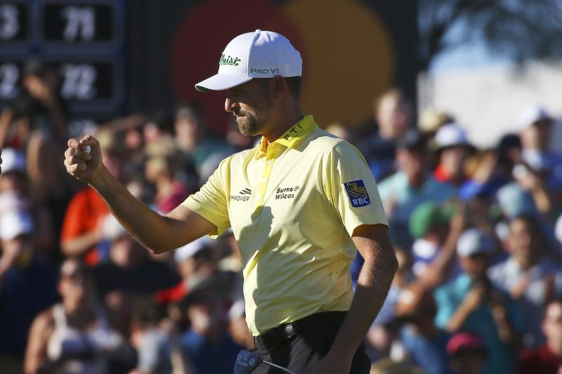 Webb Simpson celebrates making a birdie on the 18th green forcing a playoff during the final round of the Waste Management Phoenix Open PGA Tour golf event Sunday, Feb. 2, 2020, in Scottsdale, Ariz. (AP Photo/Ross D. Franklin)