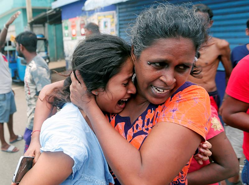 Locals react to the news of the bombings, where 290 people were killed and more than 500 injured. Source: Reuters