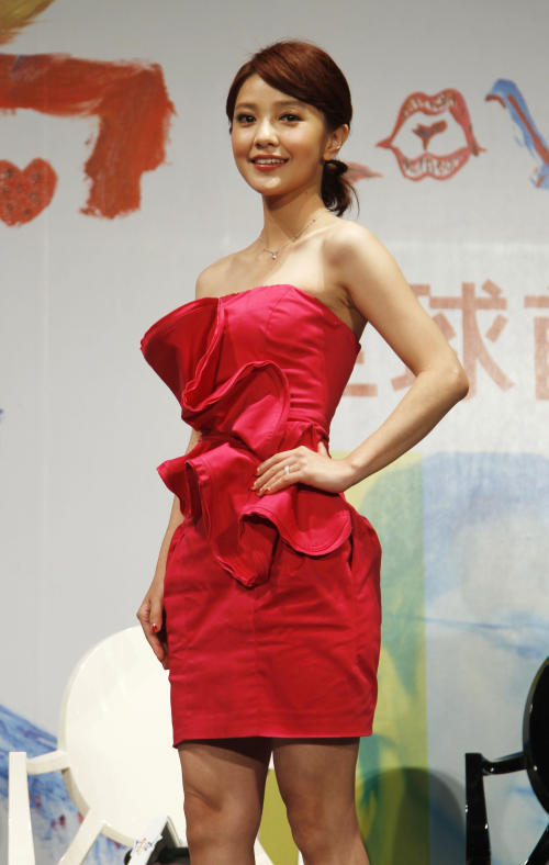 "Taiwanese actress Amber Kuo poses during a media event in the lead up to the premiere of her new film entitled ""Love"" in Taipei, Taiwan, Tuesday, Feb. 7, 2012. The romantic drama ""Love"" opens on Valentine's Day, Feb. 14, 2012. (AP Photo/Wally Santana)"