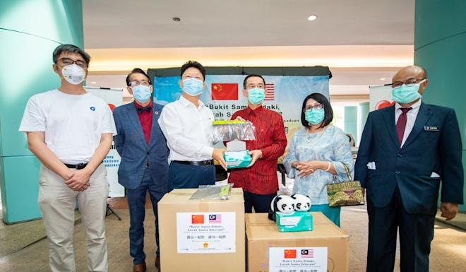 Chinese Ambassador to Malaysia Bai Tian, third from left, at the handover ceremony for the first batch of medical supplies donated by China on March 19. Photo: Xinhua