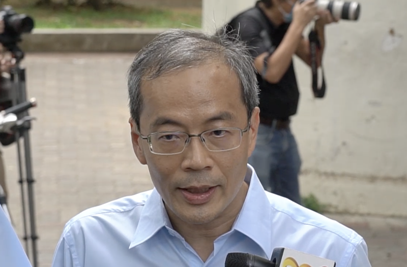 (SCREENSHOT: Workers' Party's ex-NCMP Dennis Tan speaking to reporters at Hougang on 30 June 2020 after the end of submissions by candidates on Nomination Day/Yahoo News Singapore)