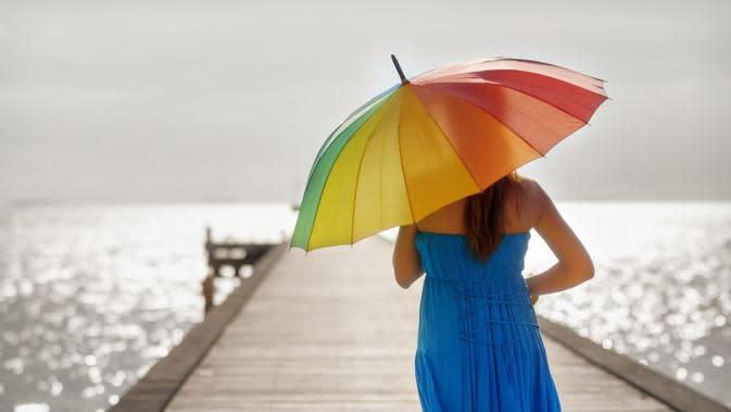Ilustrasi payung. (via. magic4wall)