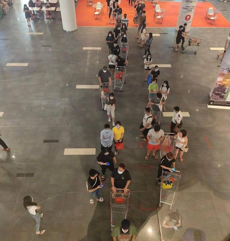 Bird's eye view of trolley-armed shoppers queuing outside Jaya Grocer in Sunway. Photo: Malaysia Shopping Mall/Facebook
