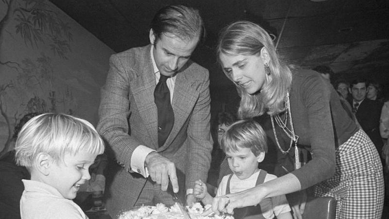 Joe Biden cuts a birthday cake with his wife Nelia in the 1970s.