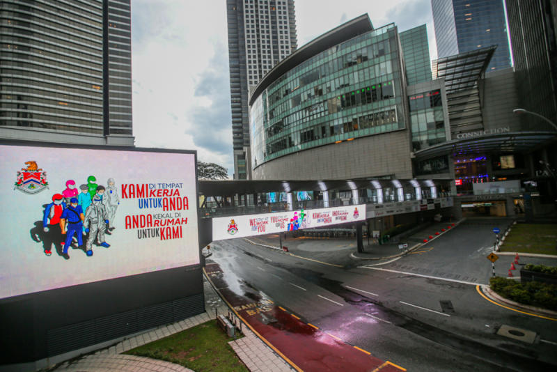 A giant LED advertising board displaying a message on the movement control order is pictured in Kuala Lumpur April 16, 2020. — Picture by Hari Anggara