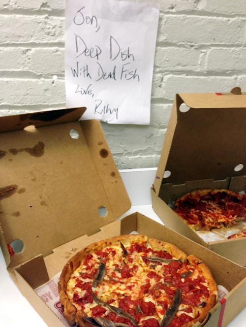 In this photo provided by The Daily Show and Zhubin Parang are two Chicago-style deep-dish anchovy-covered pizzas that were sent to comedian Jon Stewart accompanied by a note saying: Jon, Deep Dish With Dead Fish. Love, Rahm. Stewart denounced Chicago-style deep-dish pizza during a show Wednesday, Nov. 13, 2013 as an above-ground marinara swimming pool for rats. That didn't sit well with Chicagoans and Mayor Rahm Emanuel's office fired back sending the pizzas with the accompanying note. (AP Photo/The Daily Show, Zhubin Parang)