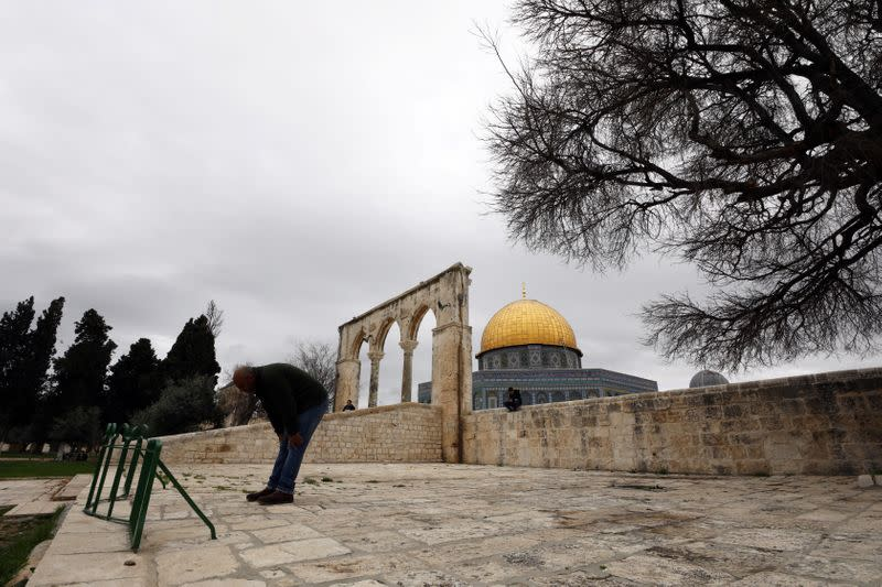 A worshipper prays in front of the Dome of the Rock in the compound known to Muslims as Noble Sanctuary and to Jews as Temple Mount, in Jerusalem's Old City