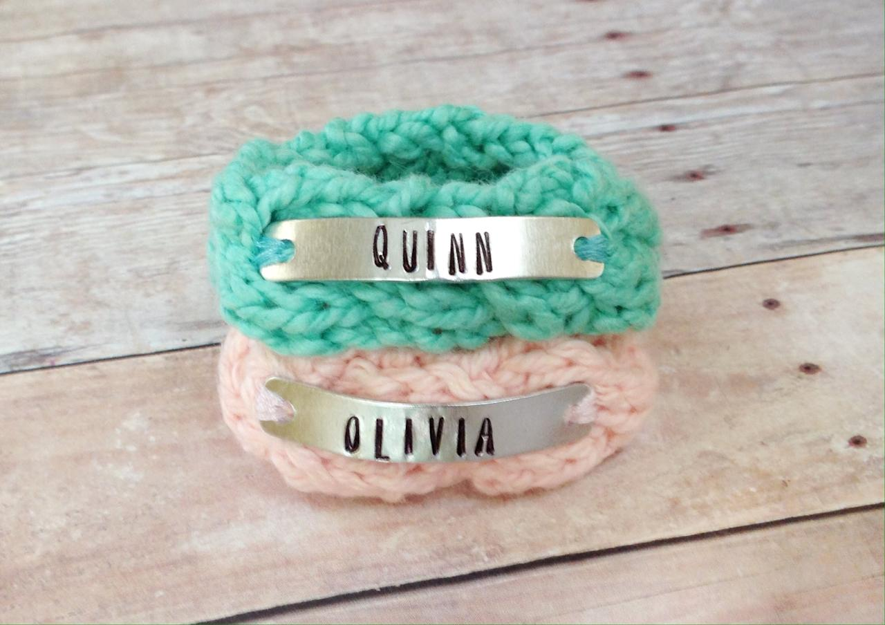 "<p>Mama will be able to tell her look-alike twins apart (at least in the beginning) with these sweet <a rel=""nofollow"" href=""https://www.popsugar.com/buy/Personalized%20Identical%20Twin%20Knit%20Bracelets-424846?p_name=Personalized%20Identical%20Twin%20Knit%20Bracelets&retailer=etsy.com&price=23&evar1=moms%3Aus&evar9=40809737&evar98=https%3A%2F%2Fwww.popsugar.com%2Ffamily%2Fphoto-gallery%2F40809737%2Fimage%2F44294119%2FPersonalized-Identical-Twin-Knit-Bracelets&list1=gift%20guide%2Ctwins%2Cbaby%20showers%2Cgifts%20for%20kids%2Cbaby%20shopping%2Cgifts%20for%20babies&prop13=mobile&pdata=1"" rel=""nofollow"">Personalized Identical Twin Knit Bracelets</a> ($23).</p>"