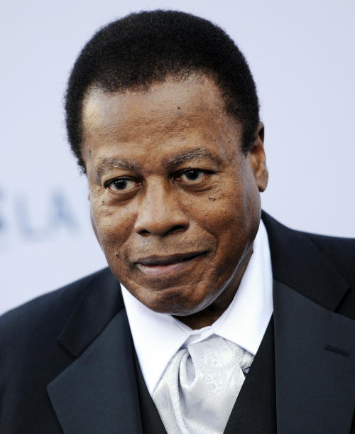 FILE - In this Sept. 27, 2011 file photo, saxophonist Wayne Shorter poses at the Los Angeles Philharmonic Opening Night Gala, in Los Angeles. The saxophonist-composer is a triple-winner in the 2013 Jazz Awards presented by the Jazz Journalists Association. Shorter, who was a member of Miles Davis' legendary mid-'60s quintet and co-founded the fusion band Weather Report, won awards for Lifetime Achievement in Jazz, top soprano saxophonist and best small ensemble. (AP Photo/Chris Pizzello, File)