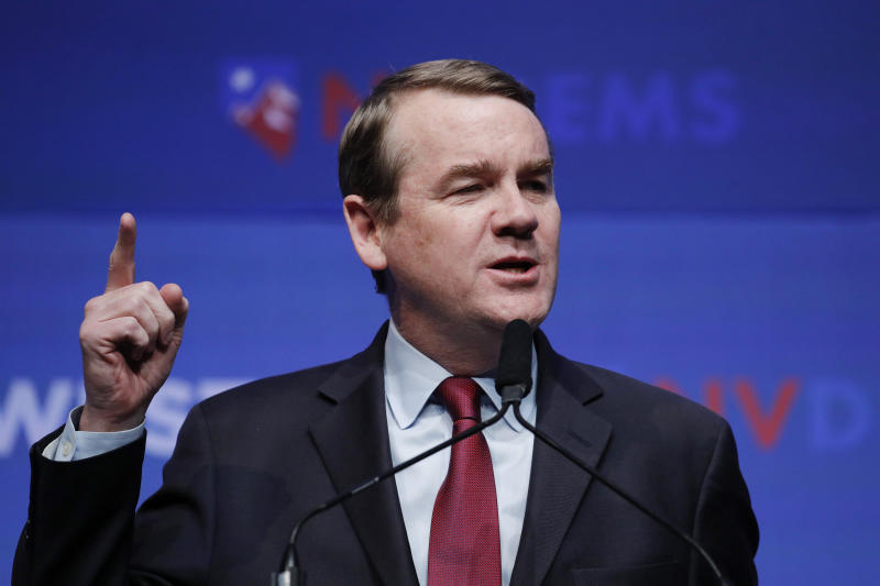 """FILE - In this Sunday, Nov. 17, 2019, file photo, Democratic presidential candidate U.S. Sen. Michael Bennet, D-Colo., speaks during a fundraiser for the Nevada Democratic Party, in Las Vegas. On Thursday, Jan. 2, 2020, Bennet released a $6 trillion plan that he called """"the Real Deal"""" in an attempt to offer what he calls a more realistic contrast with other, more liberal contenders for the Democratic nomination who have outpolled him running on more sweeping proposals that may never be implemented. (AP Photo/John Locher, File)"""