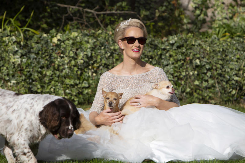 The 33-year-old made sure to include her four-legged friends in the big day [Photo: Caters]