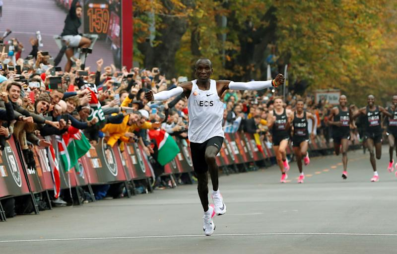 Kenya's Eliud Kipchoge, the marathon world record holder, crosses the finish line during his attempt to run a marathon in under two hours in Vienna, Austria, October 12, 2019. (REUTERS/Leonhard Foeger)
