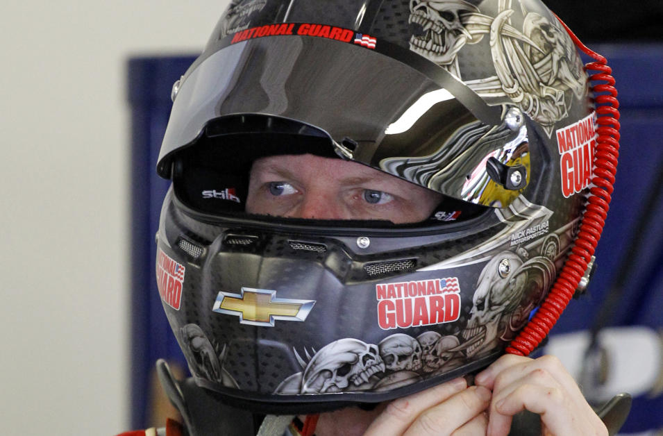 Dale Earnhardt Jr. puts on his helmet during a NASCAR Sprint Cup practice session at Daytona International Speedway in Daytona Beach, Fla., Thursday, July 3, 2014. (AP Photo/Terry Renna)