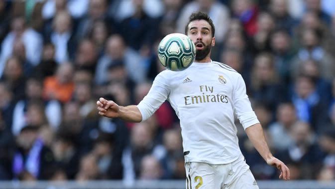 2. Dani Carvajal - Bek kanan asal Spanyol ini tampil konsisten bersama Real Madrid. Memiliki kemapuan dalam umpan silang yang baik, Carvajal turut menyumbangkan delapan assist dari 41 penampilan bersama Real Madrid musim ini. (AFP/Oscar Del Pozo)