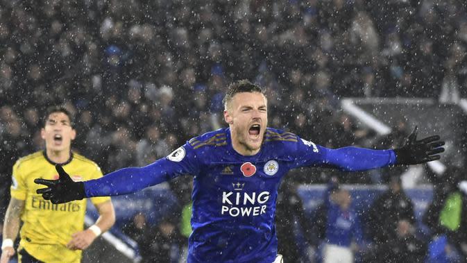 Striker Leicester City Jamie Vardy merayakan golnya ke gawang Arsenal pada pekan ke-12 Liga Inggris di King Power Stadium, Minggu (10/11/2019) dini hari WIB.(AP Photo/Rui Vieira)