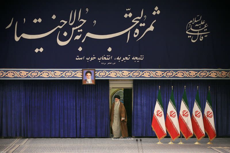 Iran's Supreme Leader Ayatollah Ali Khamenei arrives to cast his vote at a polling station during parliamentary elections in Tehran