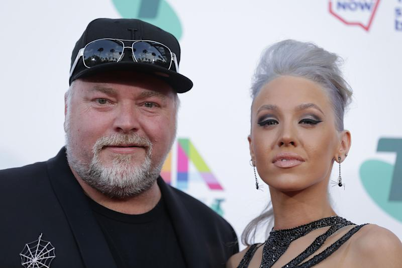 Kyle Sandilands poses on the red carpet with Imogen Anthony