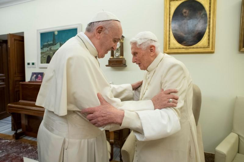 FILE PHOTO: Pope Francis visits his predecessor, Pope Emeritus Benedict XVI, at the Mater Ecclesiae Monastery in Vatican